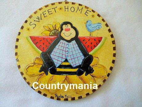 Quadro tondo con ape e anguria stile country