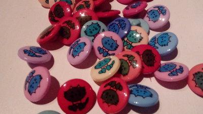 20 bottoni di plastica
