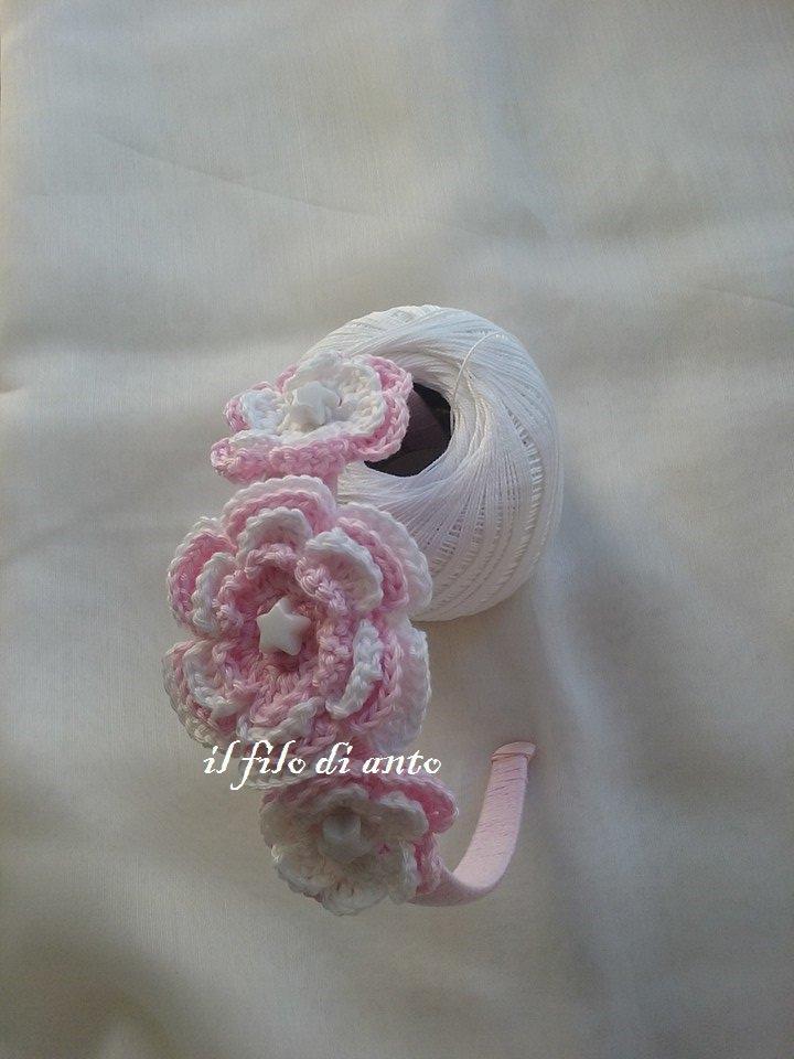 Cerchietto per capelli rosa con fiori e stelle