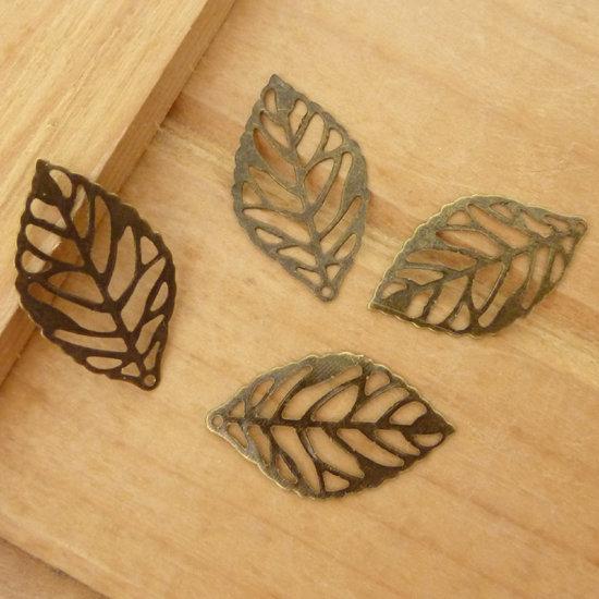4 Ciondoli connettori foglie col. bronzo