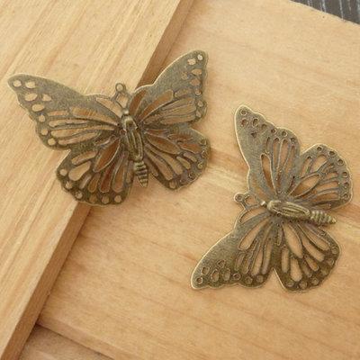 2 Ciondoli connettori farfalle col. bronzo