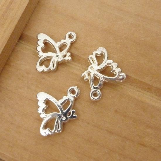 3 Ciondoli farfalle argentati