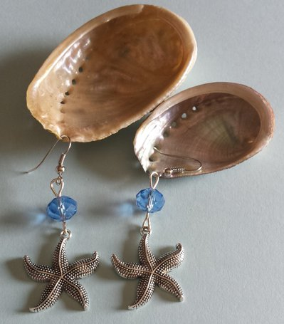 Orecchini charms stelle marine e cristalli azzurri