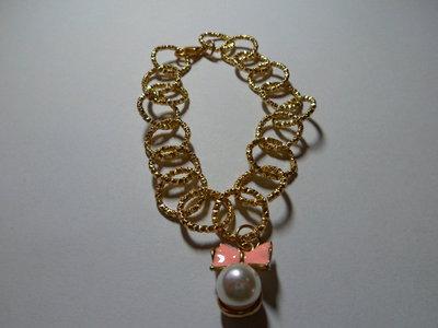 Bracciale con ciondolo perla con fiocco rosa pesca
