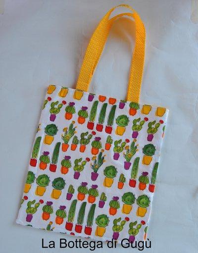 Shopper richiudibile fantasia cactus/giallo pois bianchi con borsina