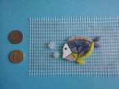 Mosaico pretagliato pesce con bollicine