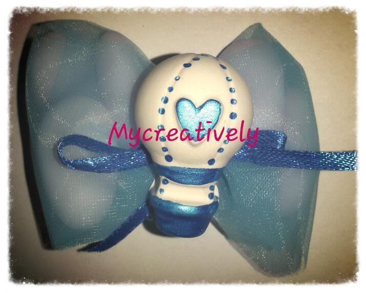 Bomboniera velo azzurro con mongolfiera decorata