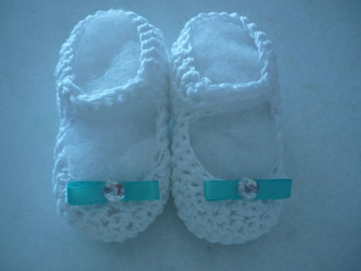 Scarpette da neonato in cotone con fiocchetto turchese