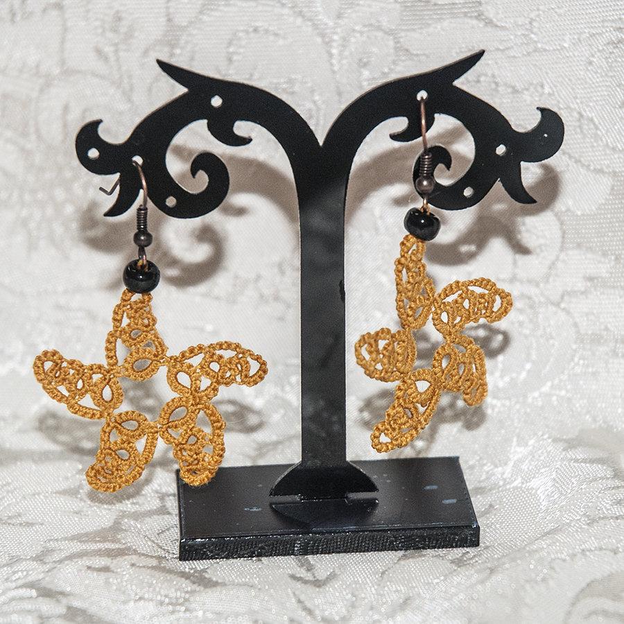 Orecchini realizzati a chiacchierino stelle marine con perlina