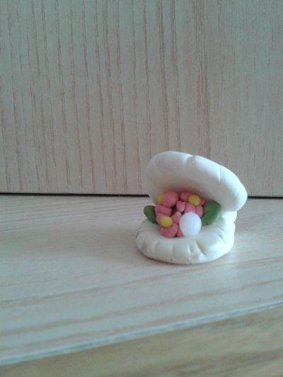 Segnaposto o bomboniera conchiglia con perla