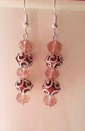 Orecchini marroni con rondelle briolettes trasparenti ed eleganti copriperla color argento