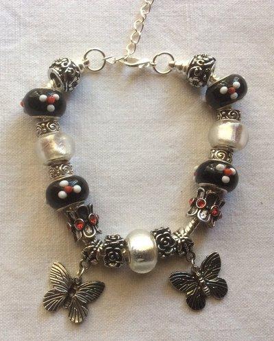 Stupendo bracciale fashion in argento tibetano e vetro di Murano con bellissimi charms