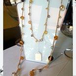 Collana realizzata con Occhio di tigre, Cristallo di rocca e Swarovsky infilati in lucente filo di seta giallo per il solare segno del Leone.