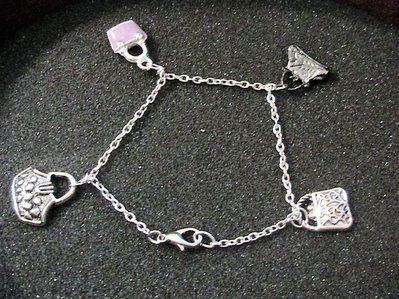 Bracciale con 4 borsette in argento tibetano
