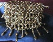 Bracciale con perline dorate