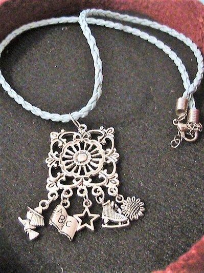 Ciondolo etnico con charms in argento tibetano