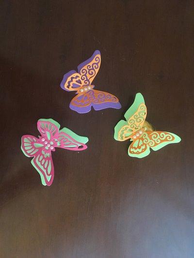 Farfalle tridimensionali chiudipacco
