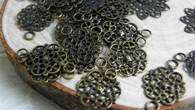 FUORI TUTTO Lottof.3  mix filigrane connettori  a fiore da circa 28-20mm color bronzo 29pz