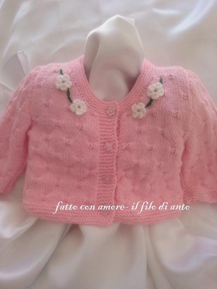 Giacchino / maglia / golfino/ cardigan in lana rosa con fiori bianchi