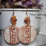 Orecchini rotondi stile Egiziano.