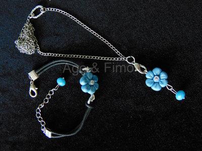 Parure di collana e bracciale in caucciù con fimo azzurro