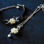 Parure collana e bracciale in caucciù con fimo perla