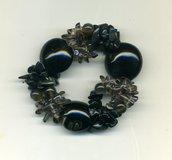 Bracciale elastico a 3 fili nei toni del grigio/nero