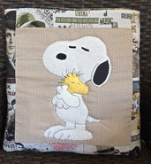 cuscino quillow Snoopy - un cuscino con dentro un plaid
