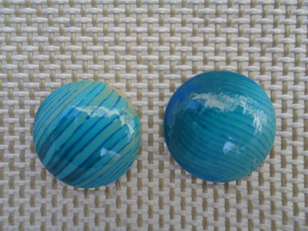 Coppia di cabochon in pasta polimerica sui toni del verde petrolio