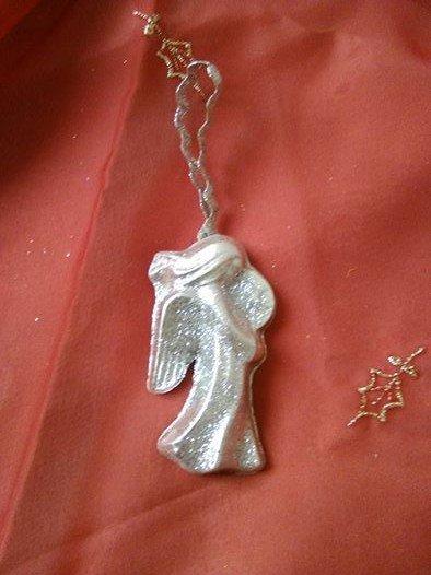 angelo argentato in polvere di ceramica