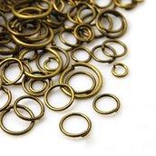 Lotto 10 grammi anellini bronzo mix 4-10mm