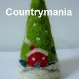 albero di Natale con casette e lana cardata