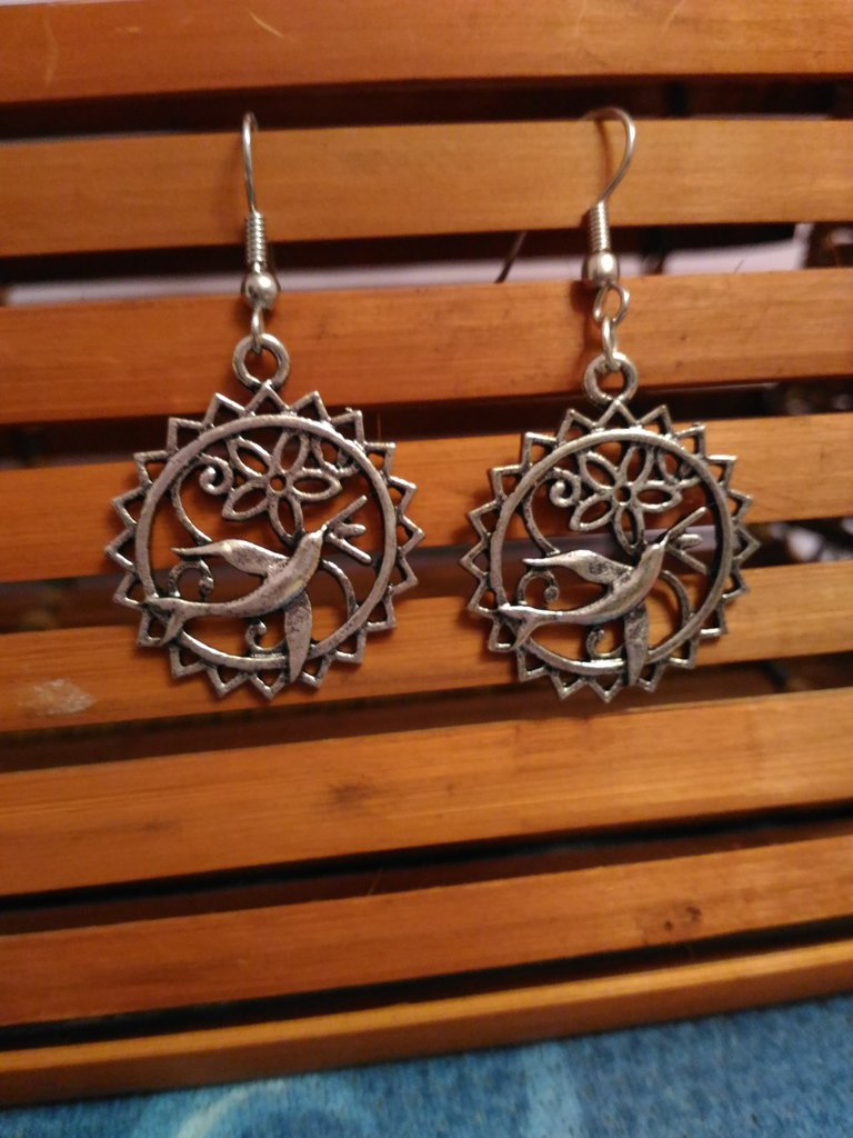Orecchini cerchio pendenti in metallo con sole  fiore rondine