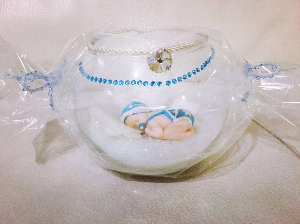 Sfera di vetro neonato in fimo