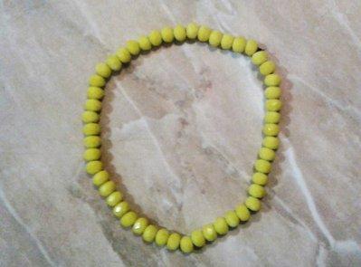 Bracciale elastico con mezzi cristalli gialli