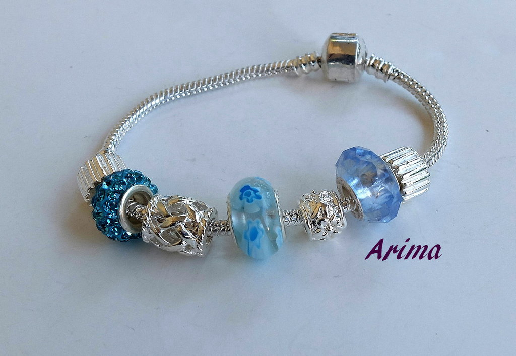 Bracciale perle e charms argentate   art 98