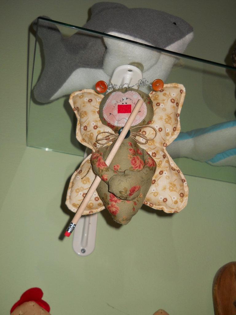 Farfalla con matita