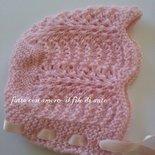 Cuffia  per neonata in lana rosa