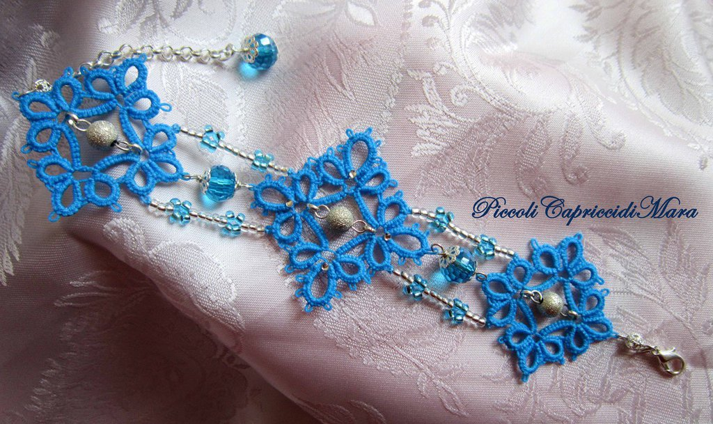 Bracciale azzurro al chiacchierino, cristallo azzurro, perle in Argento 925