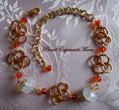 Bracciale in chainmail, cristalli arancioni, pietra di luna
