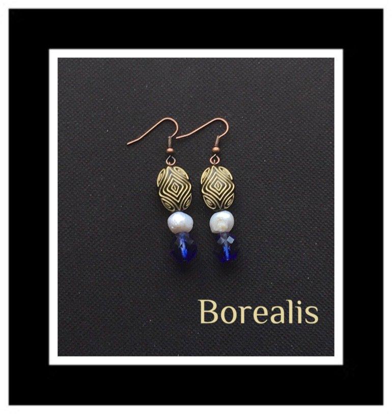 Orecchini pendenti in perle d'acqua e mezzi cristalli