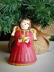 Angelo portacandelina in ceramica