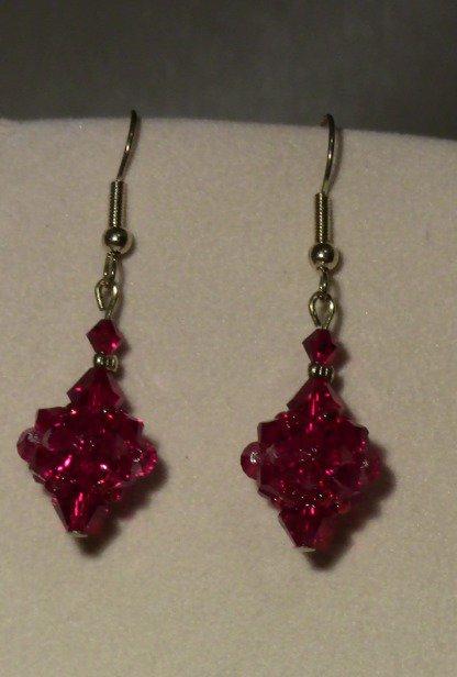Orecchini pallina Swarovski color rubino