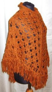 Poncho lana color ruggine con frange
