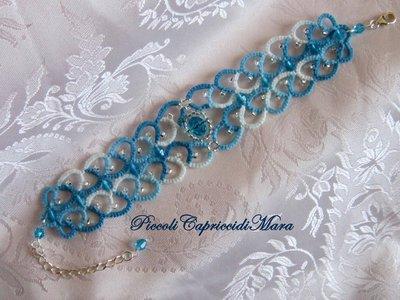 Bracciale azzurro al chiacchierino, cristalli azzurri, perline argentate