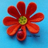 fiore fustellato con coccinella