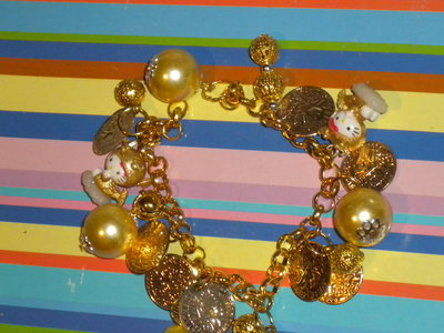 "BRACCIALE ""HELLO KITTY SIRENA DORATA"""
