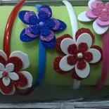 Cerchietti capelli con fiori o farfalle gomma crepla