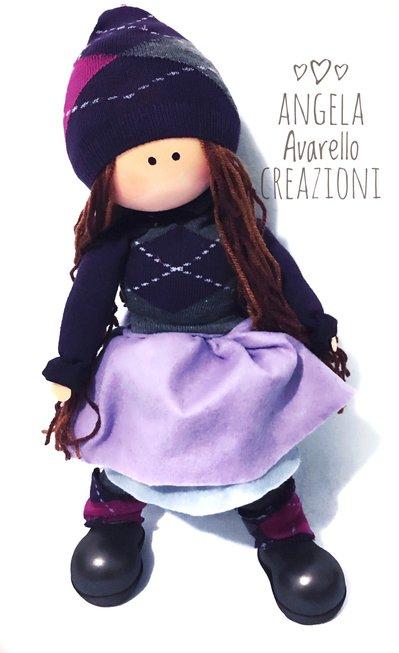 Bambola  realizzata in lana, gomma crepla e cotone