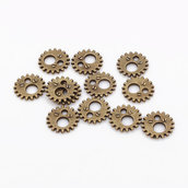 Rotelle ingranaggi steampunk 12mm tono bronzo 20pz